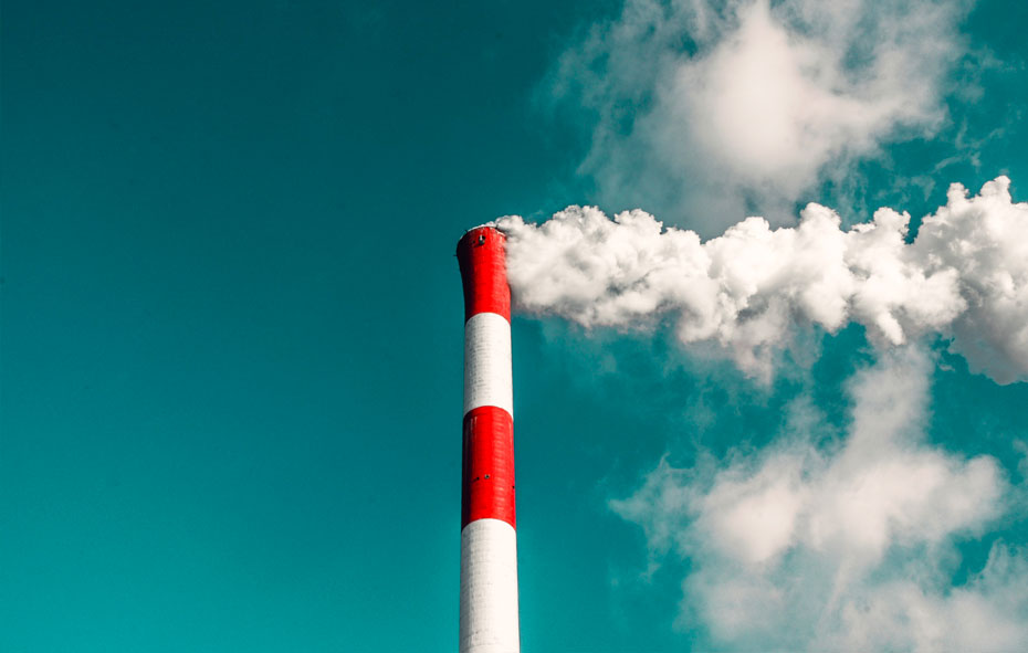 this is an image of an industrial chimney smoking