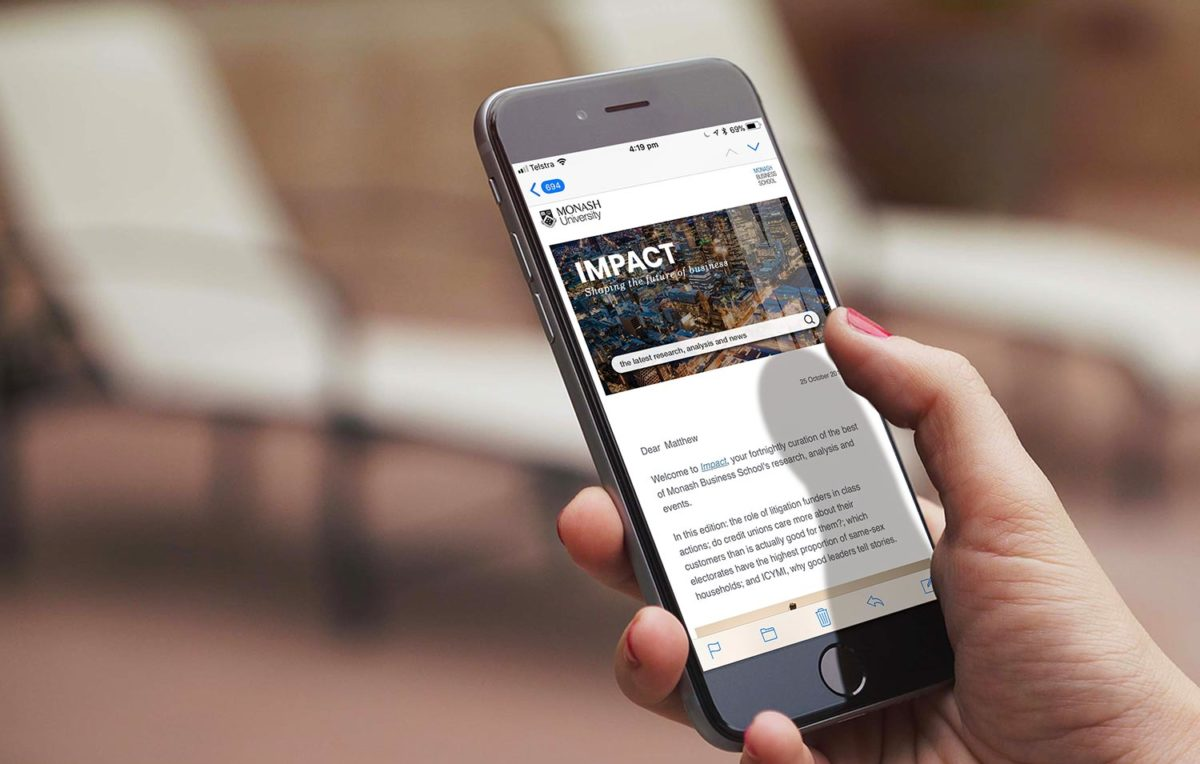 This is an image of a mobile device with the Monash Business School's Impact e-newsletter